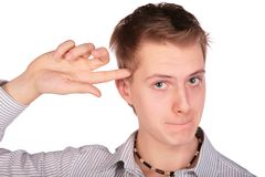 Boy gives gesture: crazy. On white Stock Images