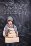 Boy gives gifts for Christmas Royalty Free Stock Photo