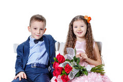 Boy gives a girl flowers on the day of St . Valentine Stock Images