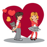 Boy gives a girl a gift.Valentine`s Day Royalty Free Stock Photos