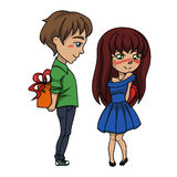 Boy gives a girl a gift, Valentine s Day Royalty Free Stock Photos