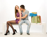 The boy gives the girl gifts Royalty Free Stock Photography