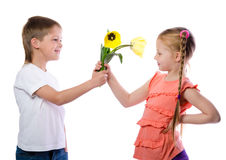 Boy gives a girl yellow tulips Stock Photo