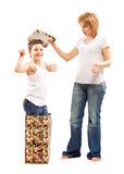 Boy gives her mother a holiday gift surprise Royalty Free Stock Images