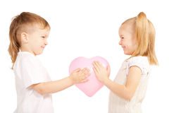 Boy gives his girlfriend pink heart. Stock Photography