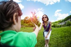 The boy gives his mother a bouquet of flowers. Wild flowers in the hands of the child. The kid makes mom a surprise. A women receives a gift from her son royalty free stock photography