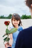 Boy gives a little girl  rose Royalty Free Stock Photography