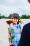 Boy gives a little girl  rose Royalty Free Stock Images