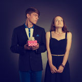 Boy gives present to girl Royalty Free Stock Photography