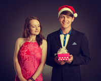 Boy gives present to girl Stock Photo