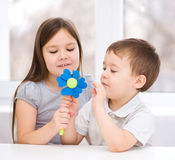 Boy gives to the girl a flower Stock Photo