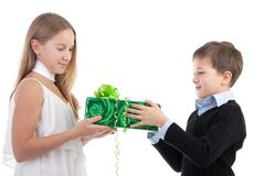 The boy gives to the girl a gift Royalty Free Stock Photo