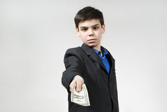 Boy gives you some money. Beautiful boy holds money in hands Royalty Free Stock Images