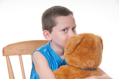 Boy giving bear friend a kiss Stock Photography