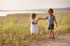 Boy giving bouquet of spring flowers to happy girl royalty free stock photos