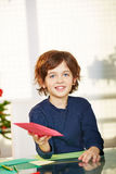 Boy giving card with wishlist for. Happy boy giving card with wishlist for christmas Royalty Free Stock Photos