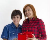 Boy is giving christmas gift to his mother Royalty Free Stock Image