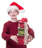 Boy giving Christmas gifts Stock Image