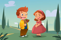 Boy Giving Flower to a Girl Royalty Free Stock Photo