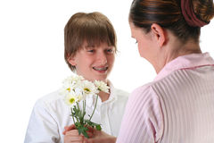 Boy giving flowers. To his mom, isolated on white Stock Photo