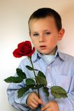 Boy giving flowers Stock Photography