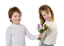 Boy giving flowers to the girl Royalty Free Stock Image