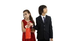 Boy giving a gift to his girlfriend Royalty Free Stock Photos