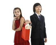 Boy giving a gift to his girlfriend Royalty Free Stock Photo