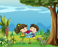 A boy giving a girl a bouquet of flowers Royalty Free Stock Image