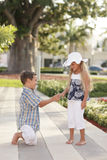 Boy giving the girl flowers Royalty Free Stock Images