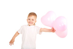Boy giving  heart balloons Stock Images