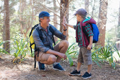 Boy giving high five to father Stock Image