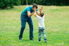 Boy Giving High Five To His Father Stock Image