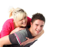 Boy giving his girlfriend piggyback ride Stock Images