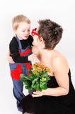 Boy giving his mother a flower Stock Image