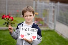 Boy giving his mother self-made greeting card Royalty Free Stock Images