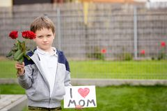 Boy giving his mother self-made greeting card Stock Images