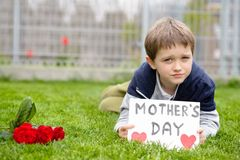 Boy giving his mother self-made greeting card Royalty Free Stock Photos