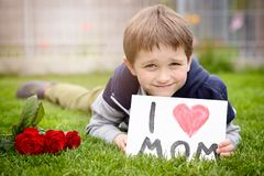 Boy giving his mother self-made greeting card Royalty Free Stock Image