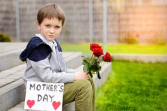 Boy giving his mother self-made greeting card Royalty Free Stock Photography
