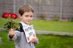 Boy giving his mother self-made greeting card Stock Photography