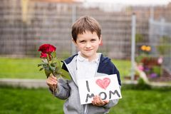 Boy giving his mother self-made greeting card Stock Photos