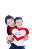 Boy giving love card to mother Royalty Free Stock Image