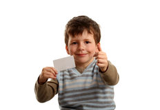 Boy giving ok with business card for text Stock Images