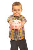 Boy giving piggy bank Stock Image