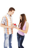 Boy giving present to girl Stock Photo