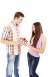 Boy giving present to girl Stock Photo