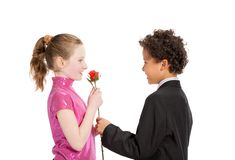 Boy giving a rose to a girl Royalty Free Stock Photos
