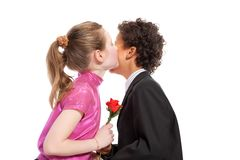Boy giving a rose to a girl. Isolated on a white background Stock Photo