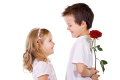 Boy giving rose to a little girl Stock Photo